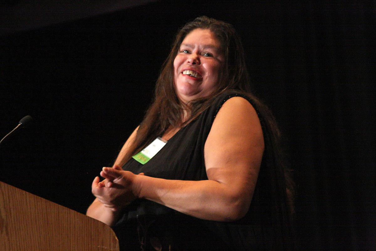 Real Change vendor of the year, Sabina Lopez on stage at the 24th annual breakfast at the Washington State Convention Center on Sept. 18. Photo by Jon Williams