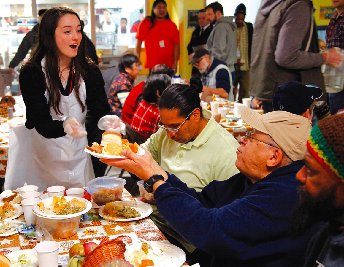 Sophia Pangallo, 17, serves meals to Thanksgiving diners at the Salvation Army in Seattle in 2015.  That year, the Salvation Army had a huge number of volunteers that equaled the amount of people coming in for a warm meal.