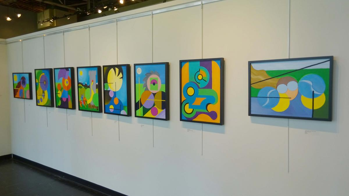 Abstract paintings from Clayton Schonberger and Mancui Schonberger hang on the wall of A/NT gallery. Photo by Lisa Edge