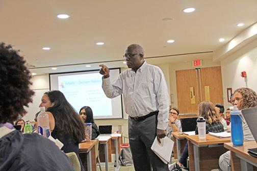 Harold Cox in the classroom, teaching students what it means to be an advocate in the local community. Photo by Michelle Samuels