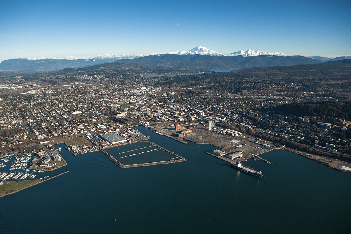 An aerial view of Bellingham including the waterfront, downtown and Mount Baker in the distance. Wikimedia photo