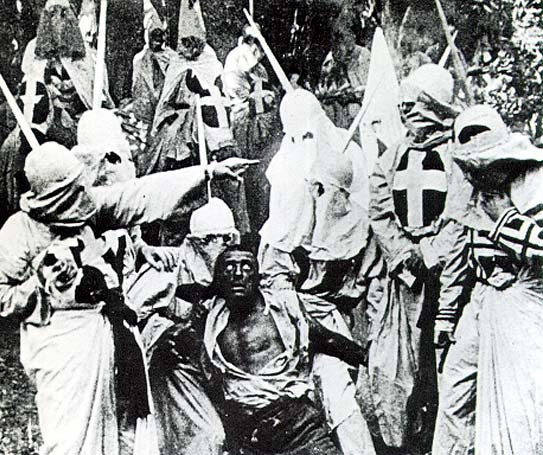 "A scene from the movie ""The Birth of a Nation,"" (1915) hooded Klansmen catch Gus, a black man portrayed in blackface by actor Walter Long. Wikimedia image"