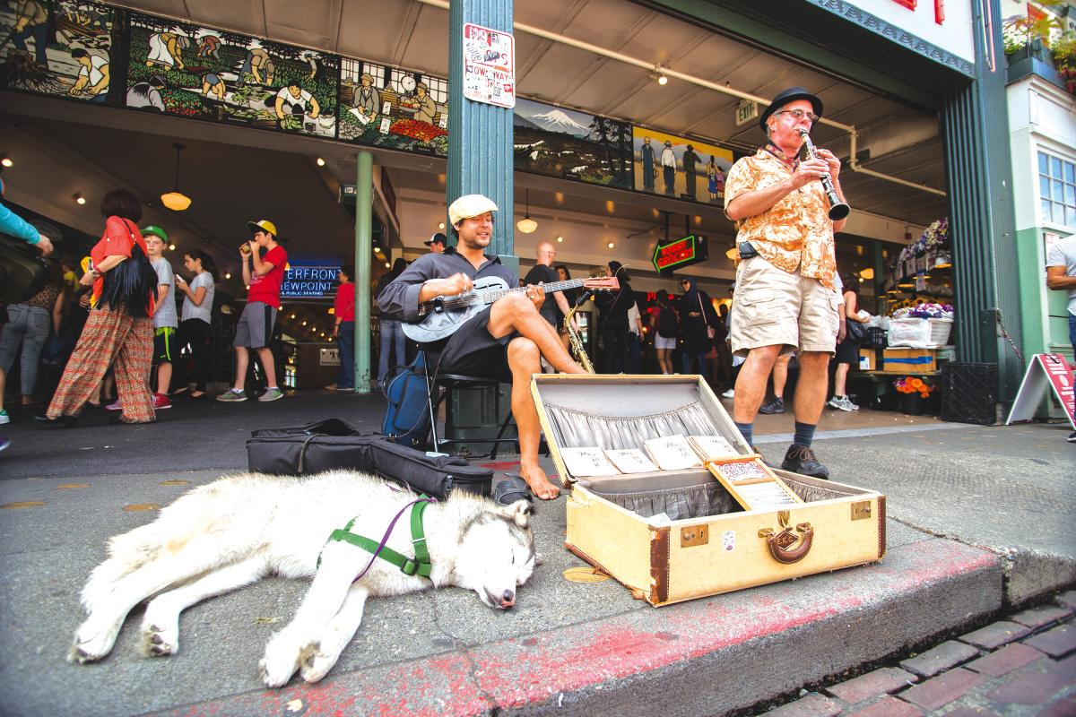 The Speakeasy Jazz Cats — Sam Deleo, left, and John Salzano — play in one of the premier spots at Pike Market. Photo by Matthew S. Browning