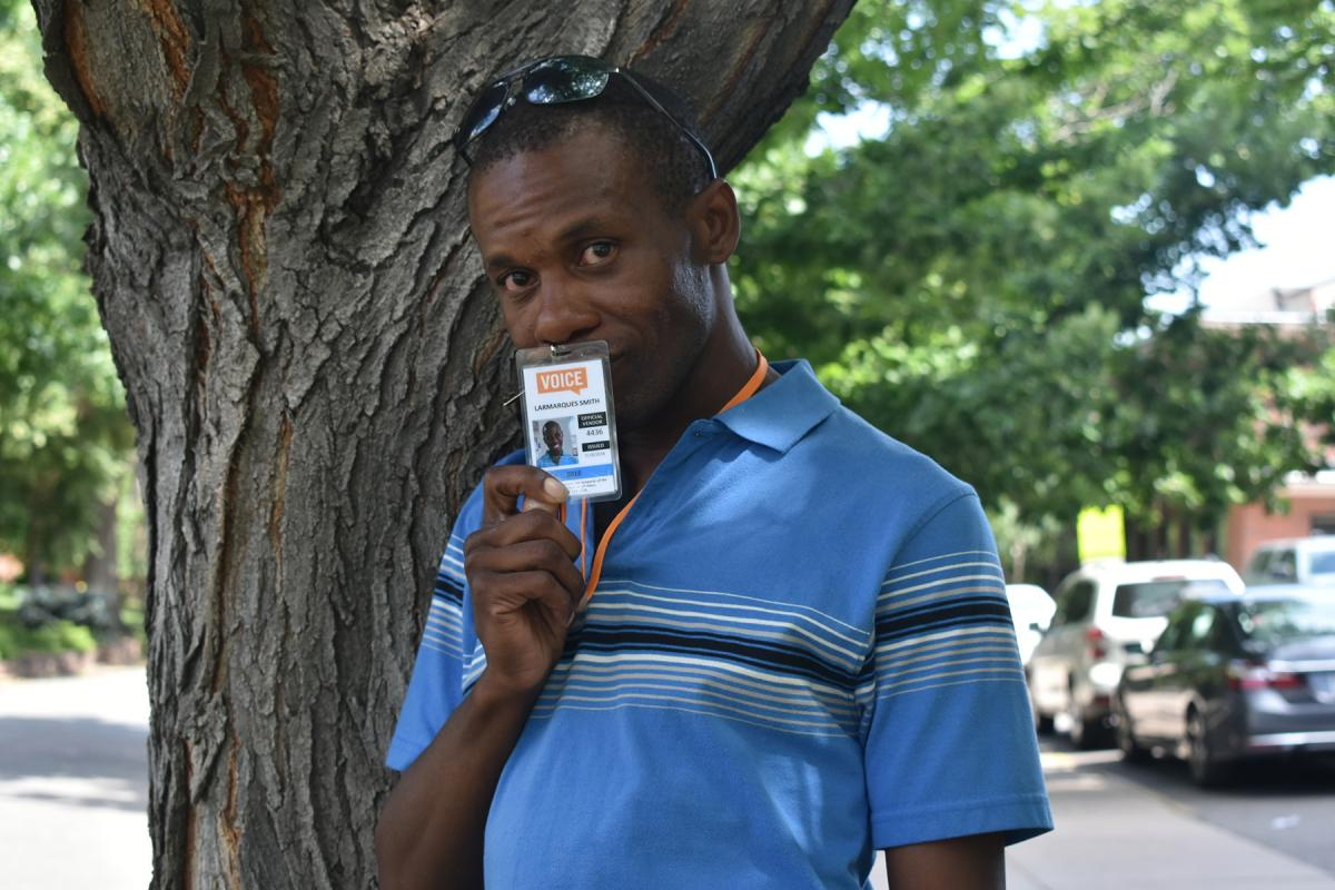 Larmarques Smith sells Denver Voice, a monthly street newspaper.