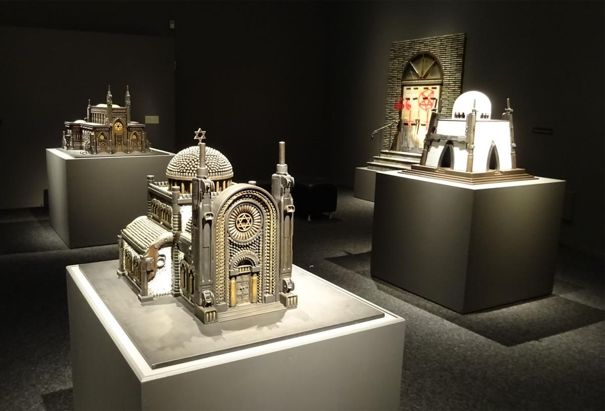 """""""Divine Ammunition"""" exhibition at Bellevue Arts Museum. Artist Al Farrow uses guns, ammunition and other weaponry to create religious structures. Photo by Lisa Edge"""