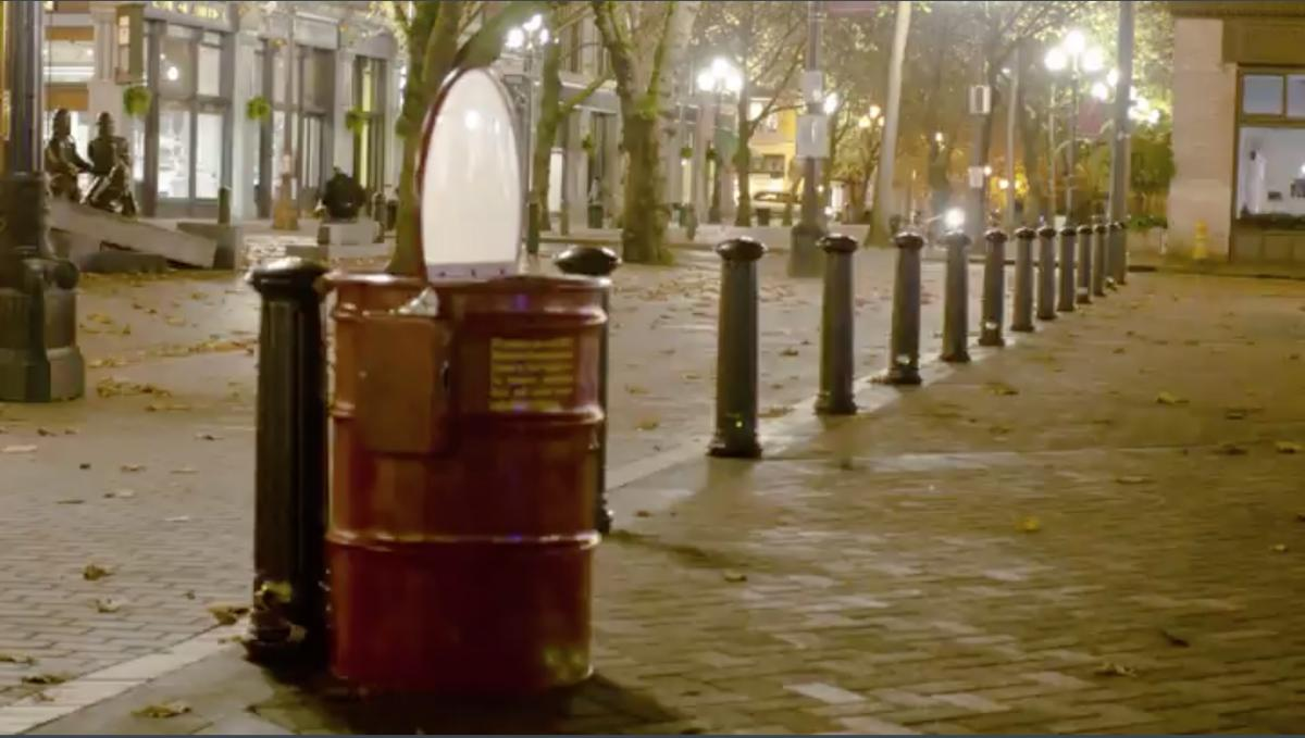 Britta Johnson's fire barrel sculpture plays a 20-second video of flames for a quarter. It will be on display at 4Culture at 101 Prefontaine Pl. S. on Dec. 1 for the First Thursday Art Walk. Photo courtesy of Britta Johnson
