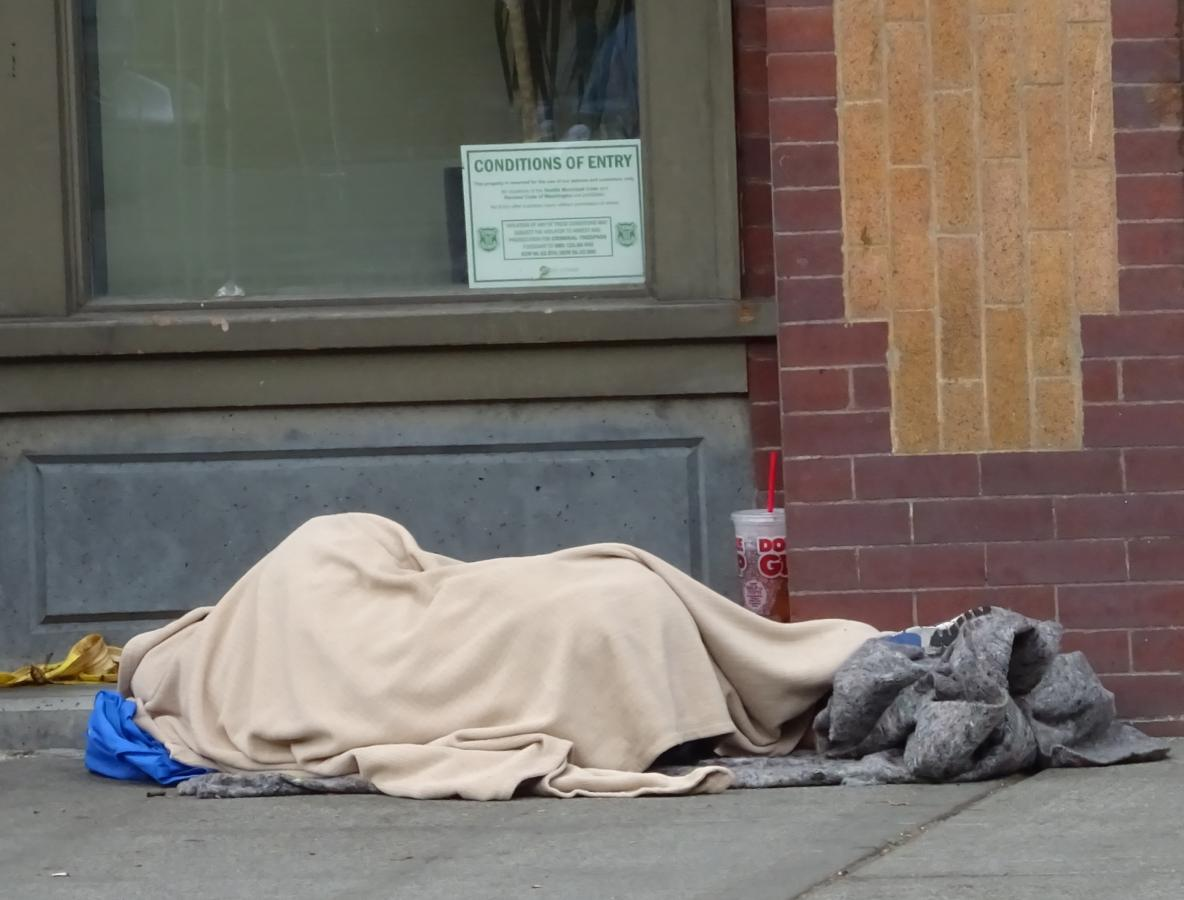 A person experiencing homelessness in Pioneer Square.