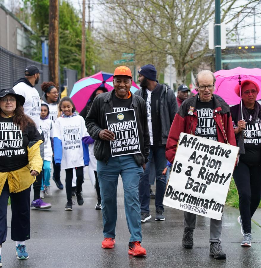 Marchers begin their journey to Olympia from south Seattle. Photo by Susan Fried.