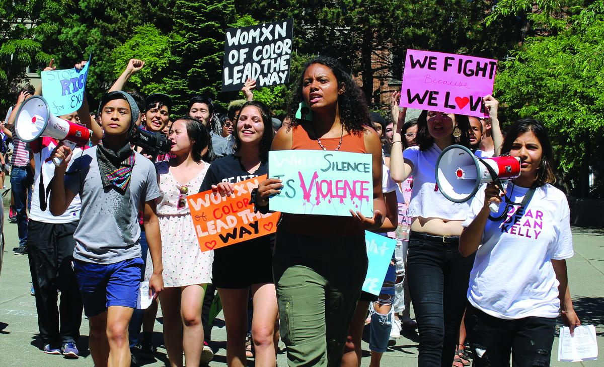 Robert Gavino, Olivia Klutse and Fiza Mohammad lead the MRC Coalition as the group of students march through Seattle University campus