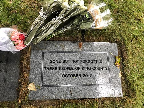 The King County Medical Examiner lays a stone to remember people whose remains went unclaimed. Photo courtesy King County Medical Examiner