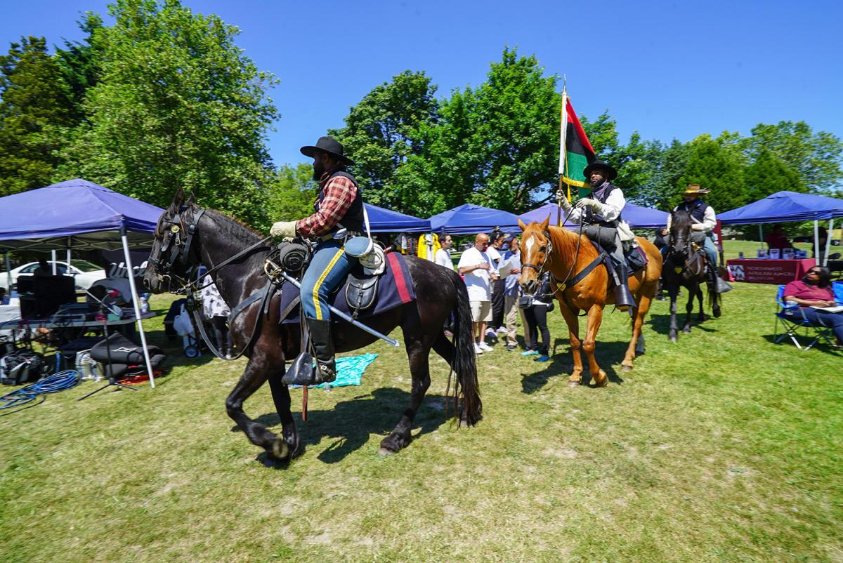 The Seattle Buffalo Soldiers ride through the 36th Annual Juneteenth International Celebration on June 15 at Pratt Park. Photo by Susan Fried