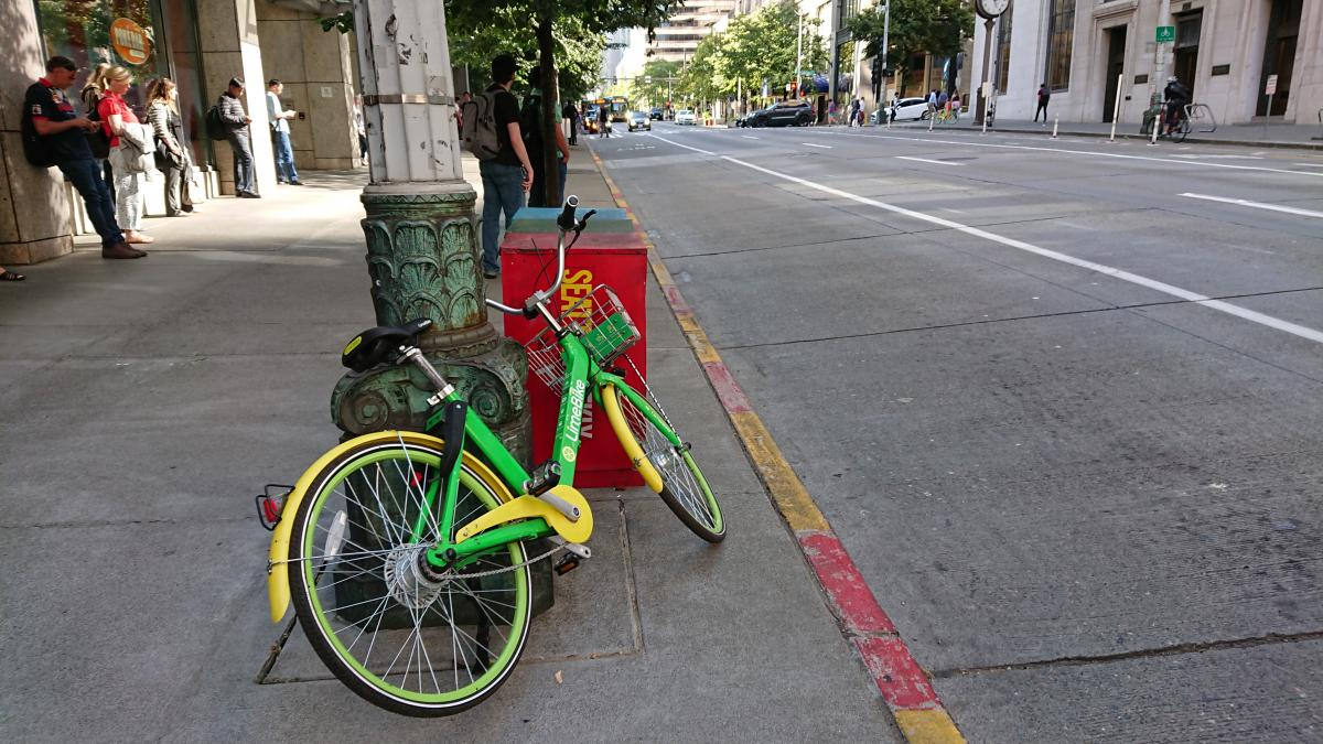 A bike from Lime parked near the intersection of Second Ave. and Cherry Street. Photo by Lisa Edge