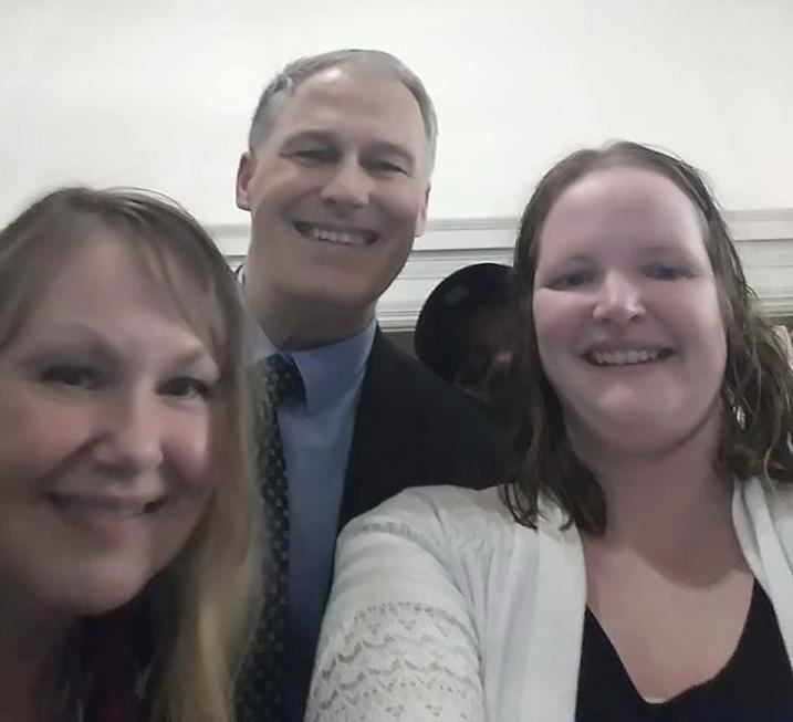 Lisa Sawyer right, with Gov. Jay Inslee and Mindy Woods at the Governor's Mansion.