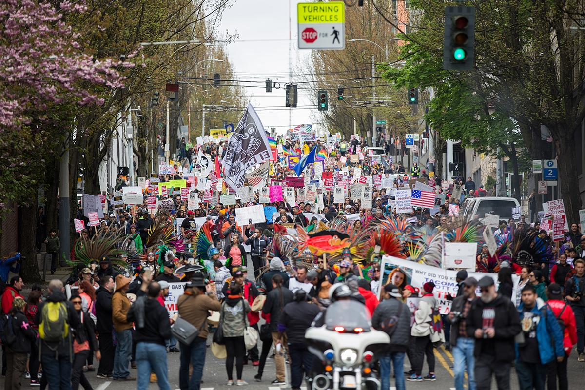 Thousands take part in the March for Workers and Immigrant Rights, which began in Judkins Park and ended at the Seattle Center. Photo by Alex Garland