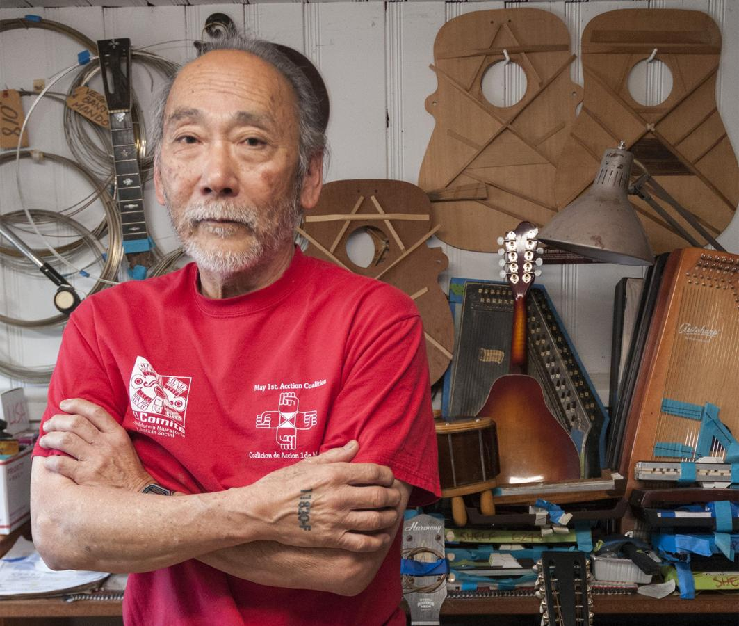 Seattle Black Panther Party member Mike Tagawa drove a bus for King County Metro from 1980 to 2016. Now retired from Metro, Tagawa repairs Martin Company guitars. Photo by Monica Westlake