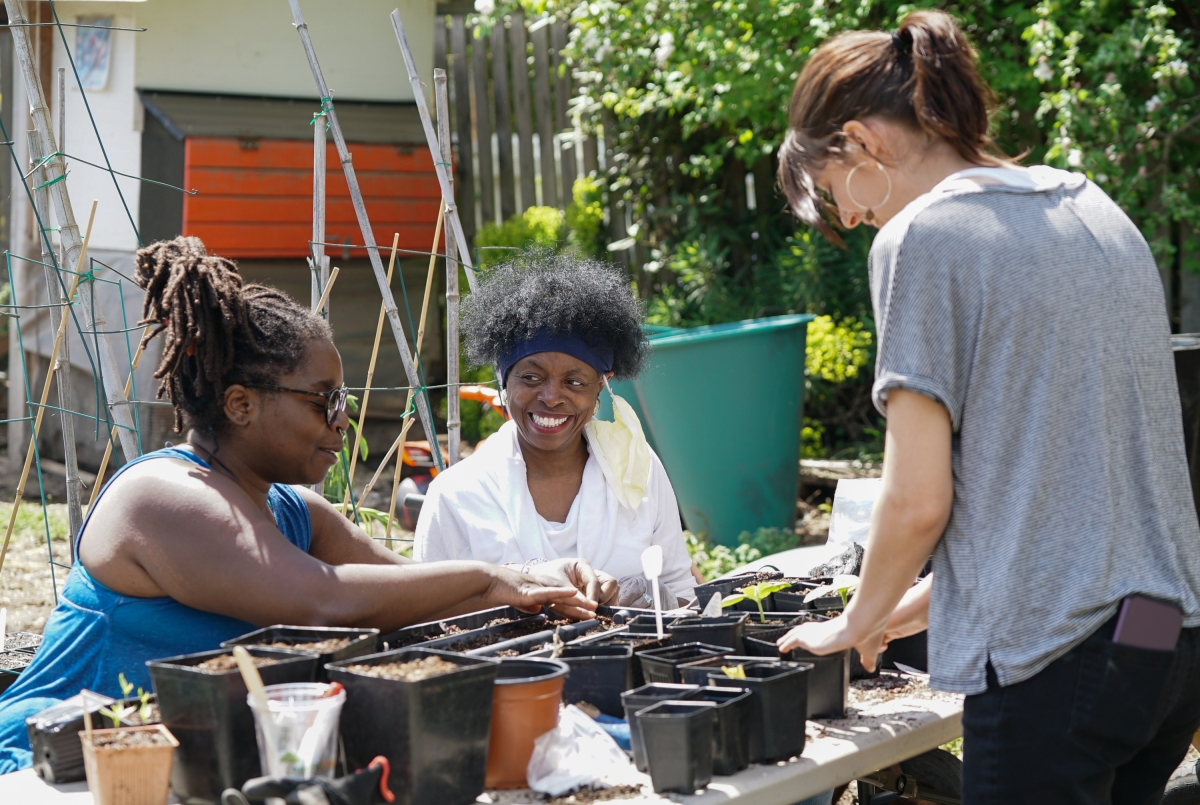 Volunteers Kema Jones, Deborah Vanderhorst and Alia Taqieddin transplant starts at Nurturing Roots Farm Sunday, April 19.