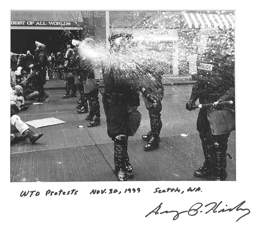 Real Change contributing photographer George P. Hickey is doused with pepper spray by an SPD officer. while covering the protest. Real Change file, 1999