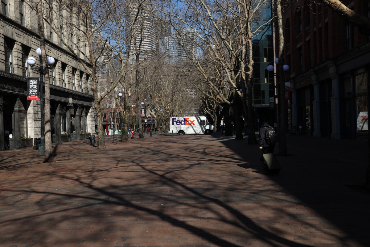 One person walks down Occidental Avenue between Main and Jackson shortly at 12:18 p.m. on Monday. It's not the usual lunch crowd.