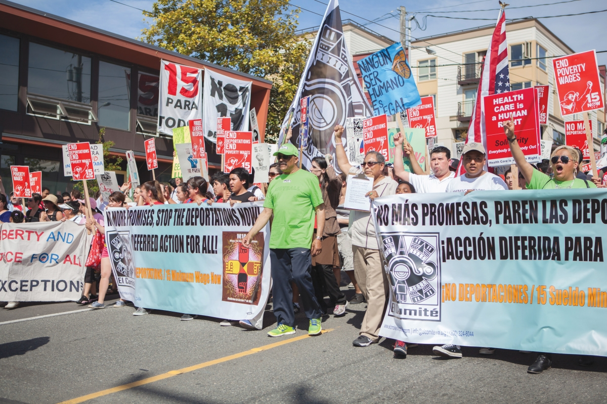 El Comité members protest at the 2014 May Day rally. This year, gatherings have been banned but members of El Comité are not willing to concede their calls for justice for immigrant workers.