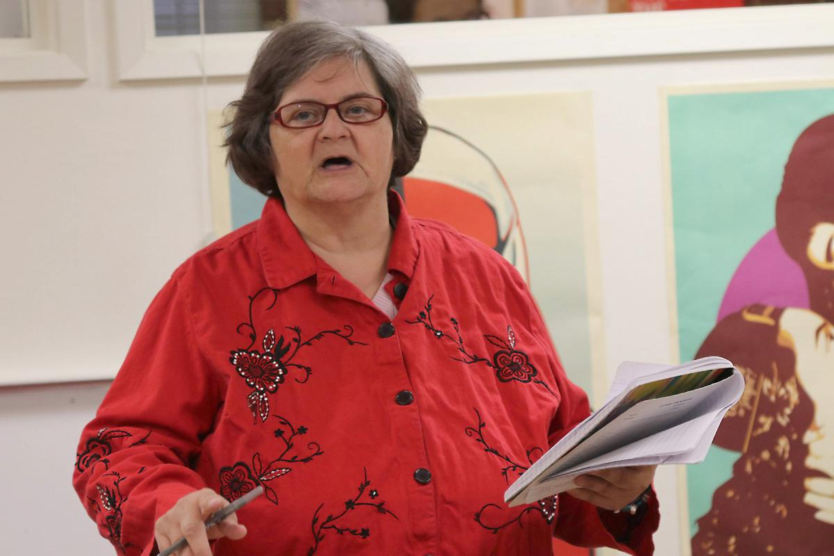 Melodie Clarke reads one of her poems to a group of fellow artists at the final Path With Art workshop. Photo by Jon Williams