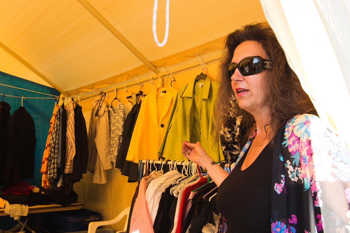 Mary Diederichs runs the donations tent at Camp Second Chance. Diederichs knows campers' sizes and finds clothing for them. Photo by Matthew S. Browning