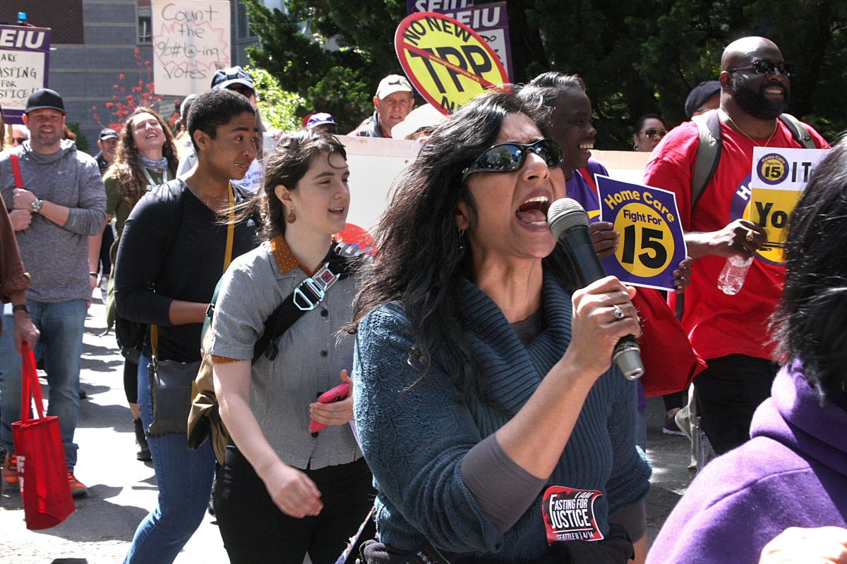Kshama Sawant marches for Seattle University adjunct professors in 2016. On Sept. 15, the council decided the city will fund her defense of a recall effort; on Sept. 16, a judge ruled the effort can move forward against her. File photo by Jon Williams