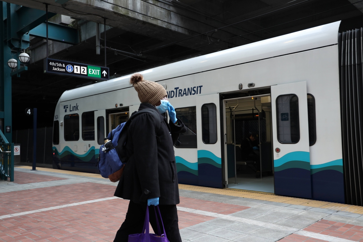 A commuter boards a Sound Transit light rail train. Fare enforcement will resume on June 1, though the fare will be discounted.