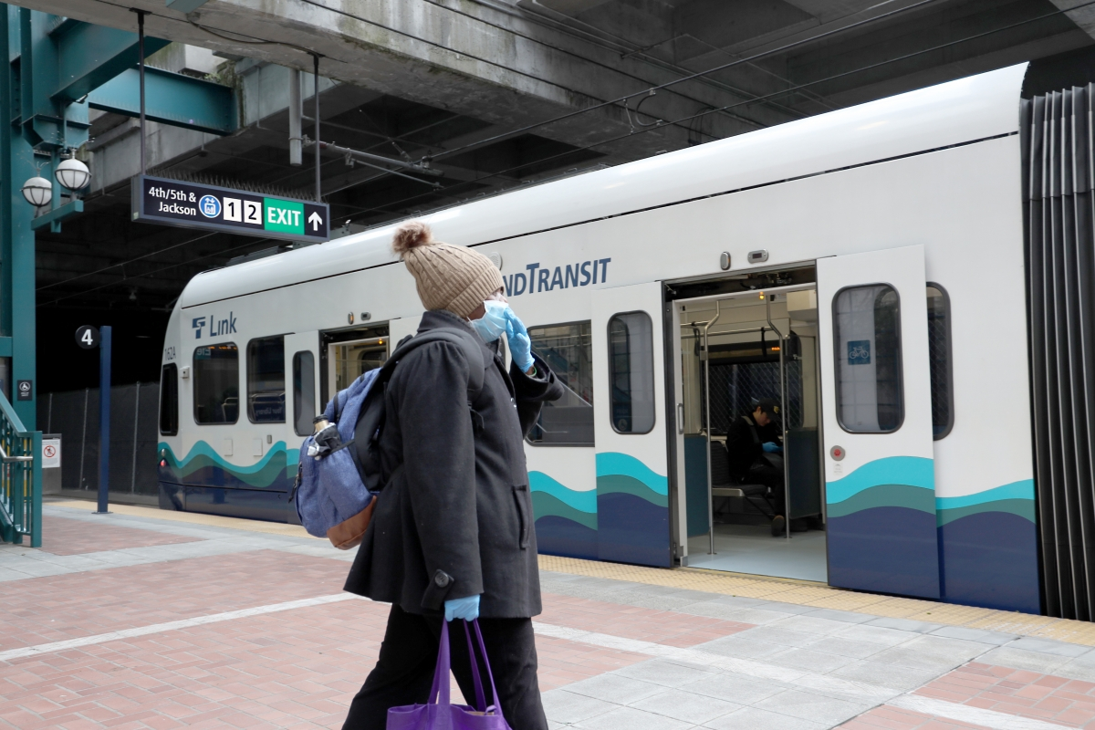 A rider boards a train in the Seattle International District station. Sound Transit's Link light rail is free during the pandemic.
