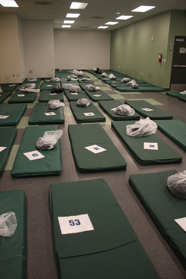 Foam mats pack the floor at the Seattle City Hall shelter, as is typical for the space alloted to people at shelters. Real Change file photo