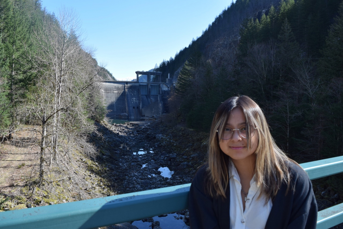 Hout-Suli-A Janelle Schuyler stands near a dam on the Skagit River.