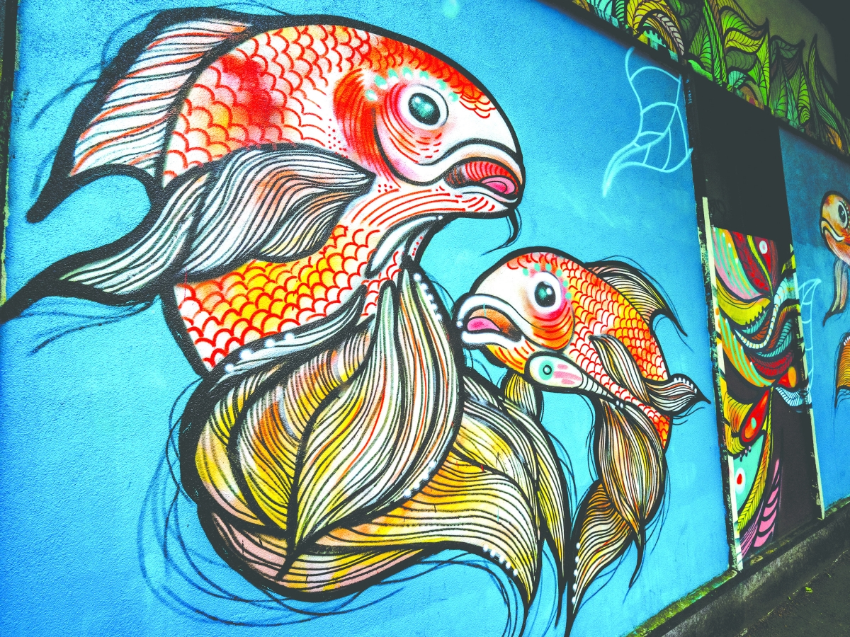 "For a mural Villalobos created in White Center, she recalls, ""... I'll just do happy little fish; a koi pond can be here; something beautiful can exist here.'"