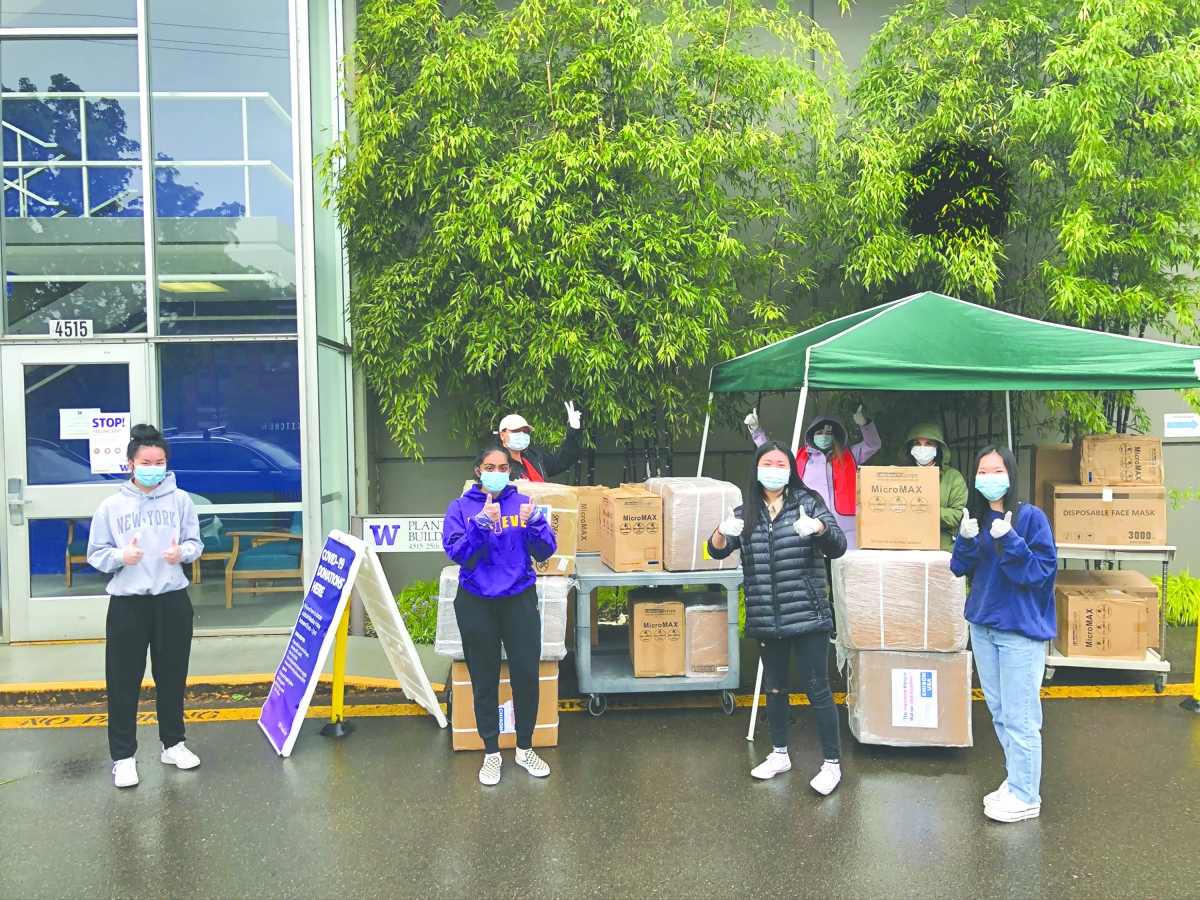 From left, Angelina Chin, Isha Rudramurthy, Claire Kang and Faith Lee stand with boxes of medical masks they provided for health care workers.