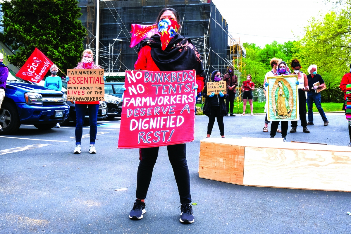 Protesters keep a physical distance and wear masks and gloves while airing their demands at a rally in Olympia. Farmworkers, many who are undocumented, are considered essential workers during the pandemic. Many live without health care.