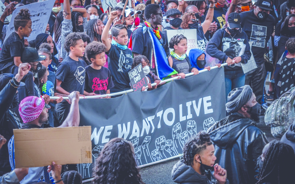 "Young people along with community members, lead a march that began at Othello Park in South Seattle to protest police. The ""We Want to Live March for Black Lives to End Violence"" was hosted by Community Passageways, a nonprofit working to end youth incarc"