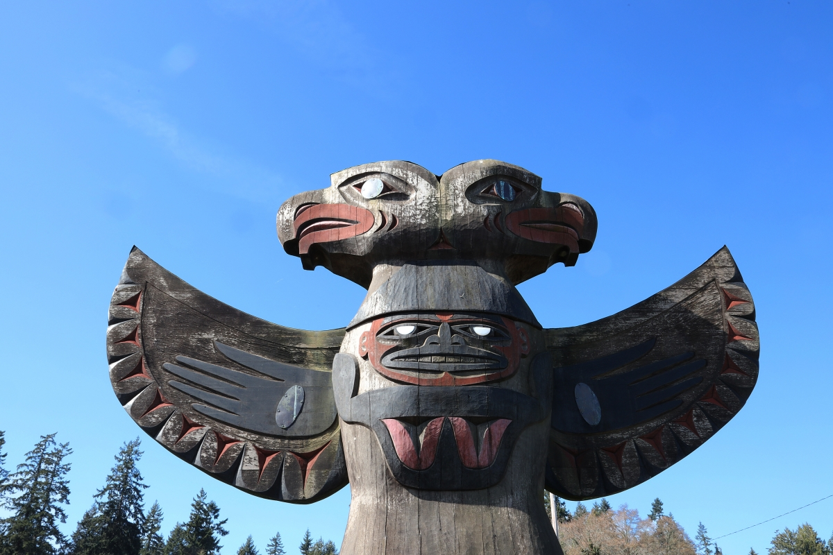 A carved bird stands in front of the Suquamish Longhouse.