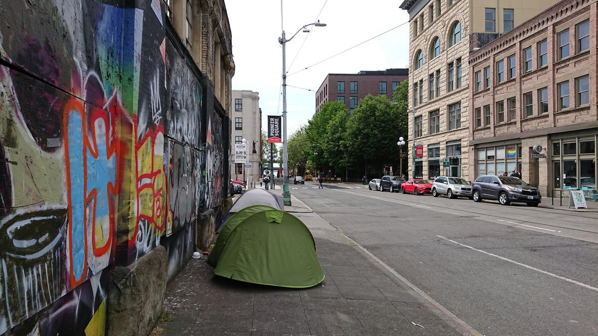 File photo. Tents line a section of Main Street in Pioneer Square. Unauthorized encampments are often swept which reinforces the instability they are already facing.