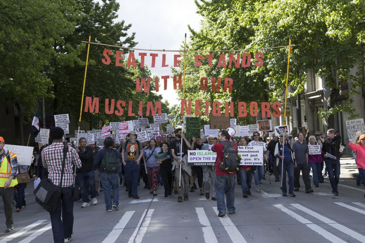 Counter protesters march from Occidental Park to City Hall where the anti-Muslim protest was taking place. Photo by Monica Westlake