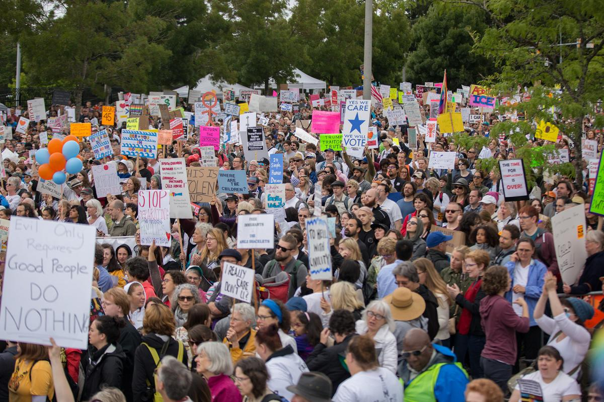Thousands of protesters gather in front of the Federal Dention Center in SeaTac to provide feedback to President Donald Trump's immigration policy that separates families trying to cross the border. Photo by Alex Garland