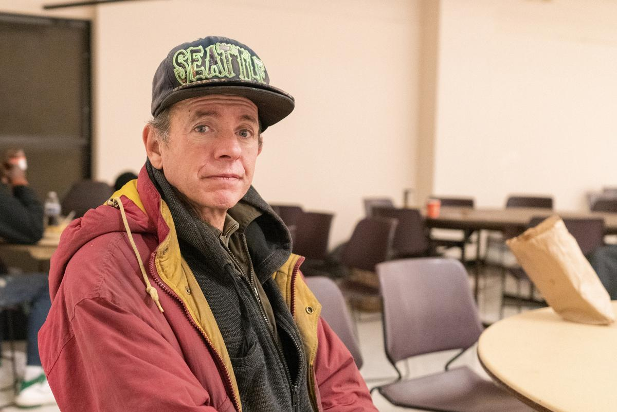 Stephen Johnson decided to stay at the severe weather shelter after his tent collapsed under the weight of the snow. Photo by Jeff Few