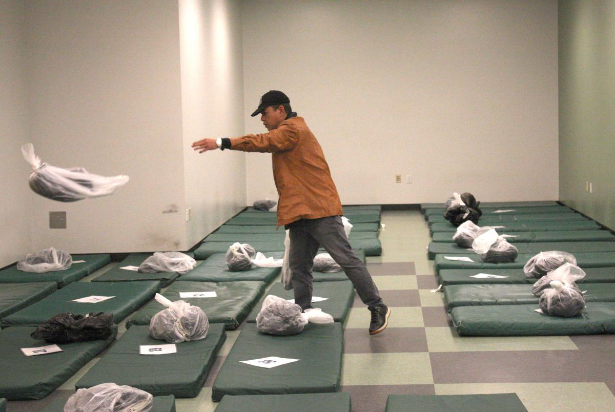Seattle's City Hall shelter run by the Salvation Army is a mat-on-the-floor model that leave people sleeping head-to-toe. Real Change file by Jon Williams, 2015