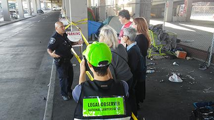 Police officers arrested two protesters with the Southeast Seattle Neighborhood Action Coalition at an encampment sweep Sept. 12, 2017. File photo by Travis Thompson