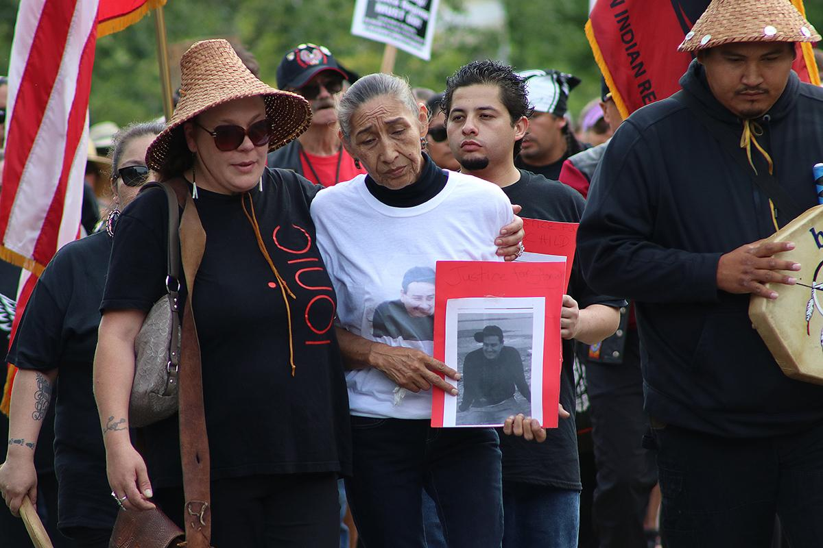 Stonechild Chiefstick's mother, center, marches through Poulsbo with members of the community and local tribal members at a peaceful memorial and protest Aug. 10. Photo by Jon Williams