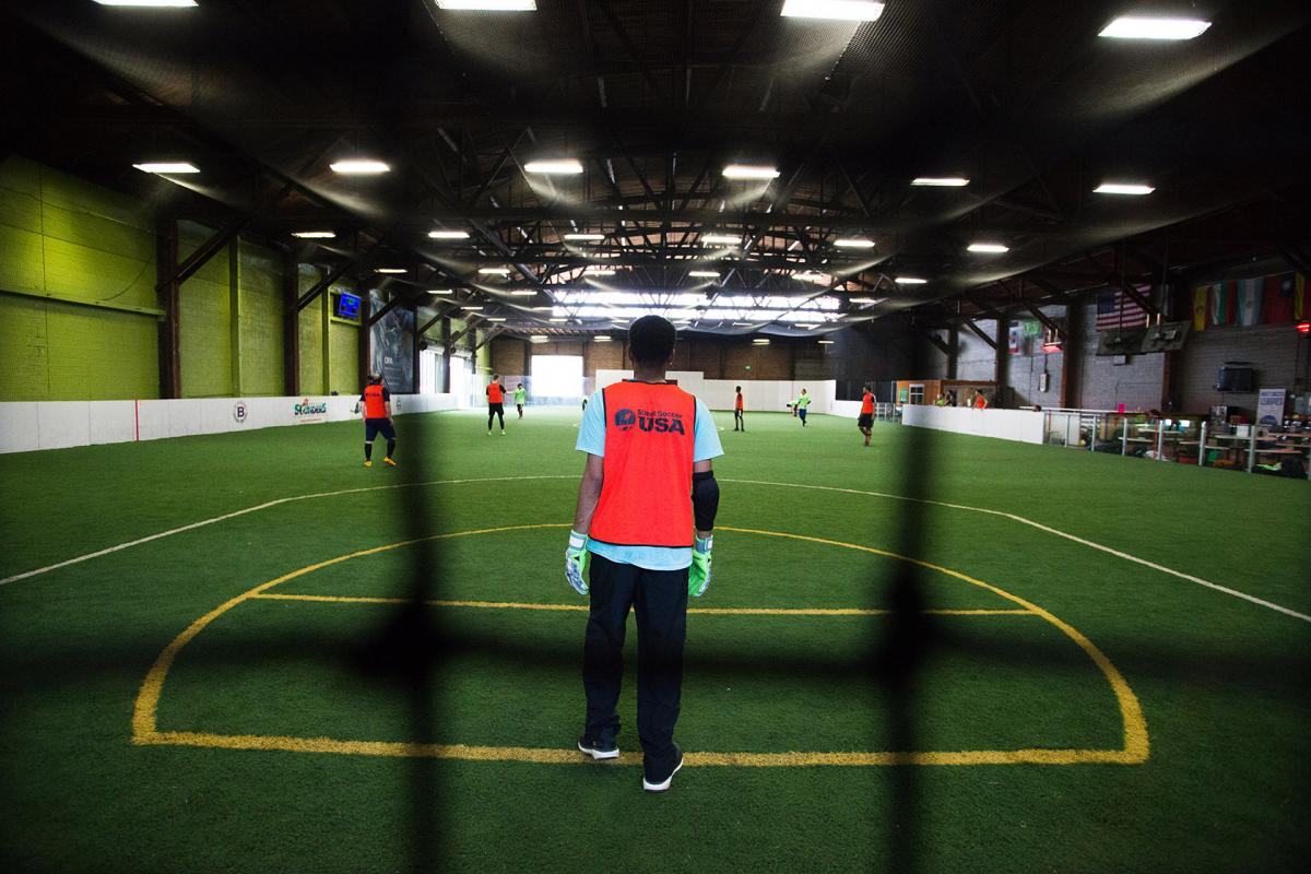 Street soccer teams from Portland, Vancouver and Seattle met at an indoor arena to play lightning rounds of soccer on March 31. Photo by Matthew S. Browning