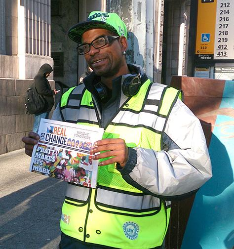 Zackary Tutwiler wearing the new high visibility vest while he sells papers at 2nd Ave. and Cherry St. The vests are provided by Granite Construction in partnership with the labor community.