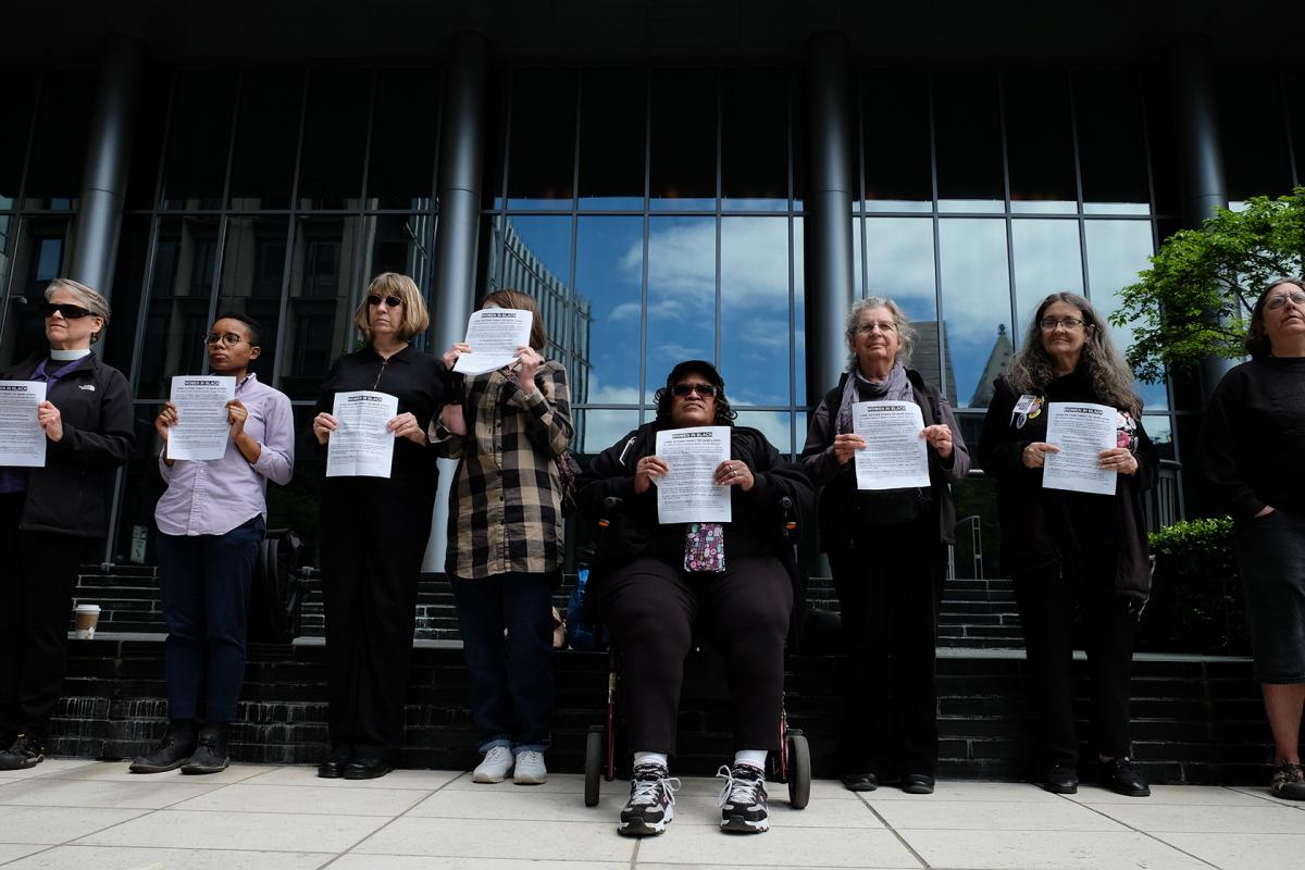 (May 2018 file photo) Members of Women in Black hold a vigil at the Seattle Municipal Court in honor of  the now 42 homeless people who have died outside this year. Photo by Alex Bergstrom