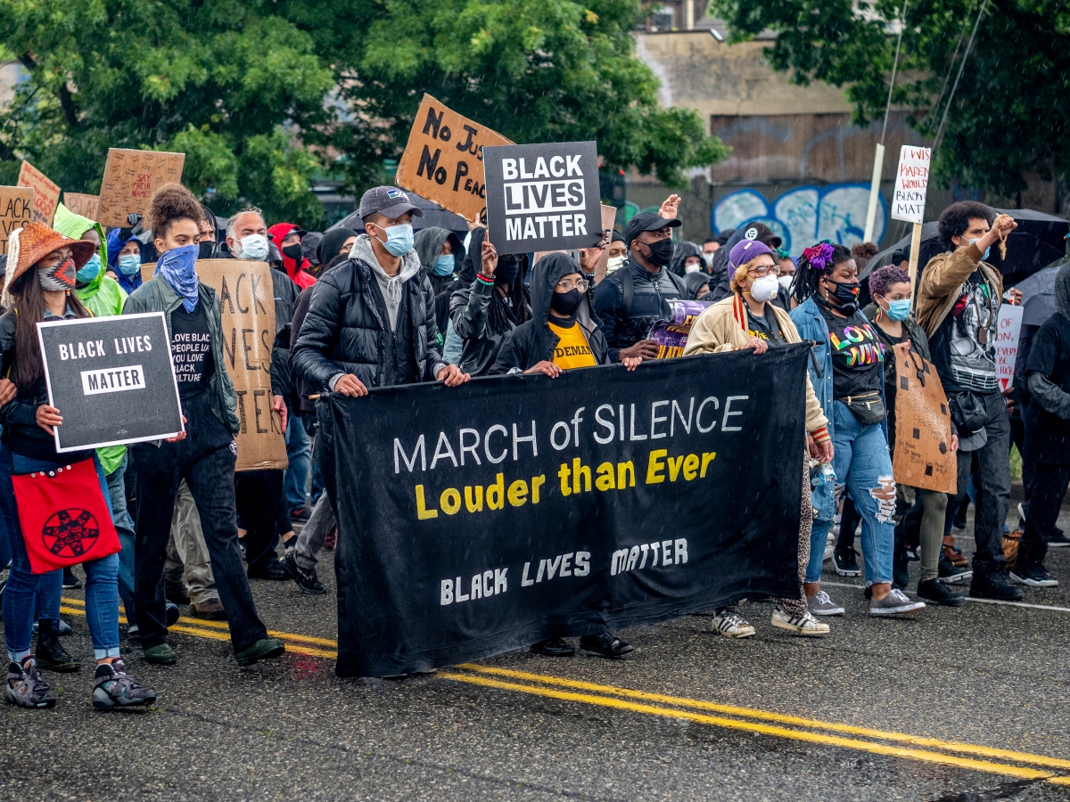 On Friday, June 12, protesters silently marched in the rain from South Seattle's Othello Park and ended in Jefferson Park with a rally and speeches.