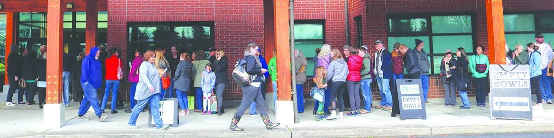People begin lining up in front of the Charles Wright Academy hours before the doors open at 1 p.m. There were more than 350 people who gathered to support the Empty Bowls annual charity event, where local potters created more than 1,000 bowls.