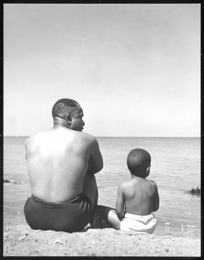 Left, Untitled photograph of father and son at Lake Michigan, 1946-1948.