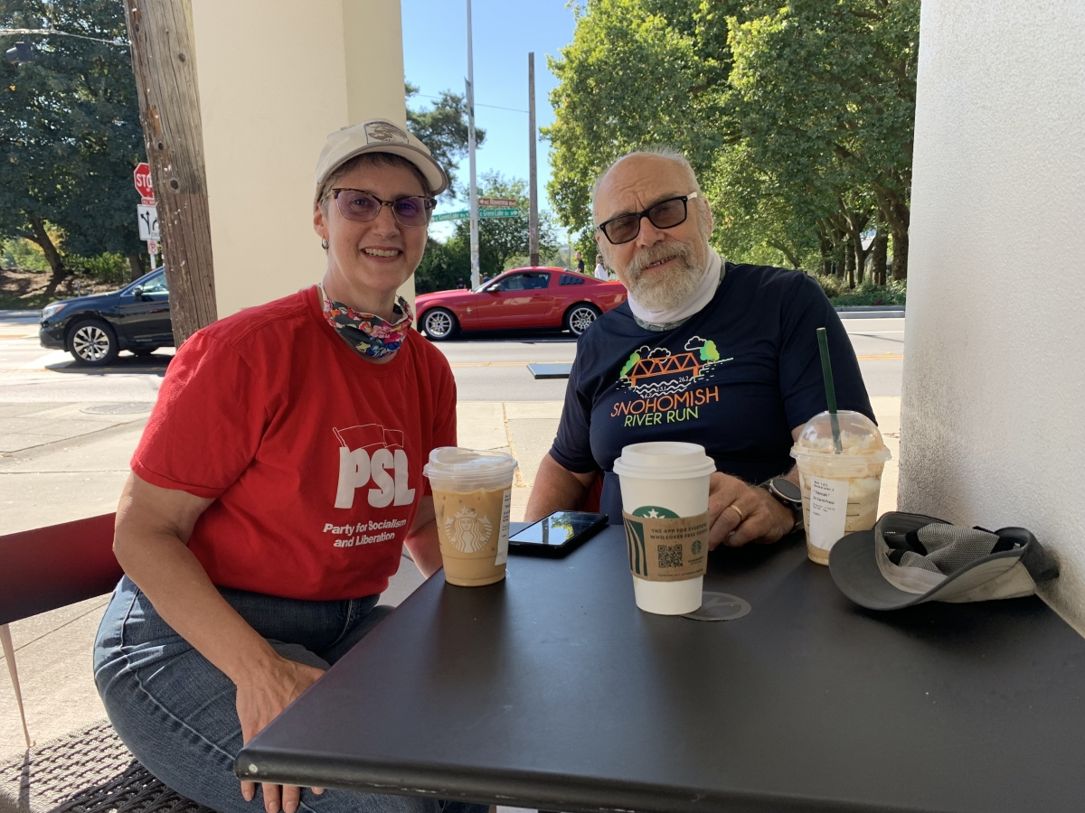 Jane Cutter, left, and Andrew Freeman, right, founding members of the Party for Socialism and Liberation, sit for a Real Change interview at a Starbucks in Green Lake about the party's radical politics that have become more mainstream, Sept. 6. Photo by H