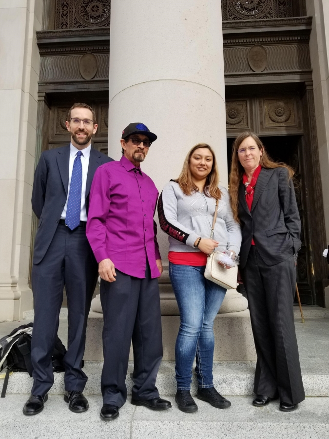 Jose Martinez-Cuevas and Patricia Aguilar (center left and right) stand with their attorneys outside the Washington Supreme Court after they presented oral arguments to win overtime pay for dairy workers. Photo courtesy of Lori Isley